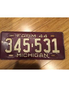 "Antique Michigan License Plate Farm 1944 345-531. White on maroon, ""Farm 44"" on top—""MICHIGAN"" on bottom  Single Plate Issued.   Condition as Pictured."