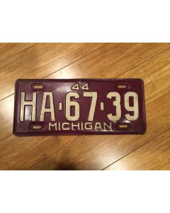 "Antique Michigan License Plate 1944 HA-67-39. White on maroon, ""44"" on top—""MICHIGAN"" on bottom  Single Plate Issued.   Condition as Pictured."
