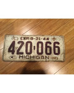 "Unique Antique Michigan License Plate 1944 420-066. Maroon on White , ""Exp. 8-31-44"" on top—""MICHIGAN"" on bottom  Single Plate Issued.   Condition as Pictured."