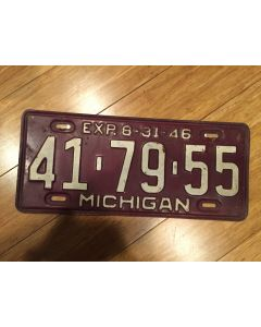 "Antique Michigan License Plate 1946 41-79-55. White on dark olive green, ""46"" on top—""MICHIGAN"" on bottom  Single Plate Issued.   Condition as Pictured.MICHIGAN"" on bottom  Single Plate Issued.   Condition as Pictured."
